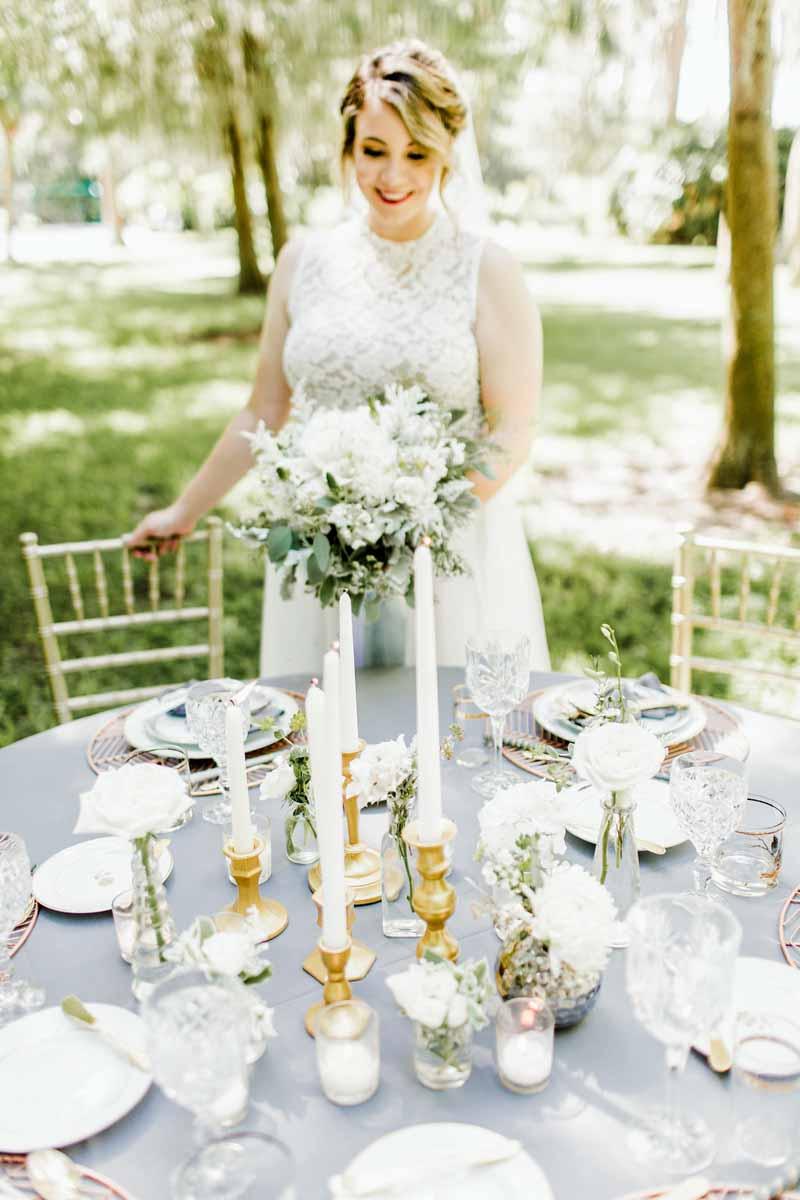 bride looking down at reception table