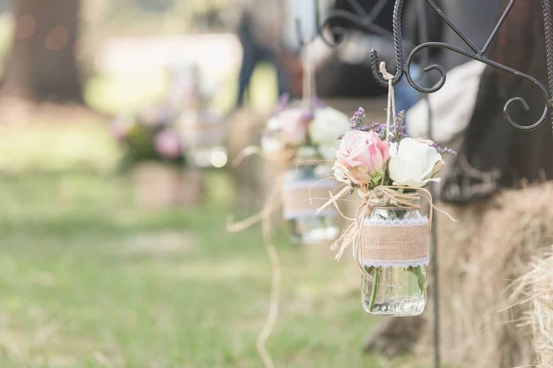 roses in hanging mason jars for rustic wedding