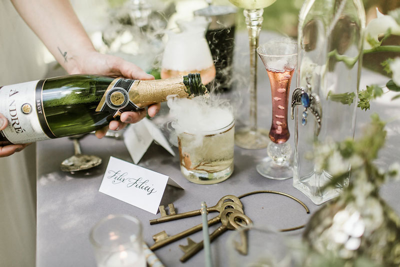 bride pouring champagne in owl glass