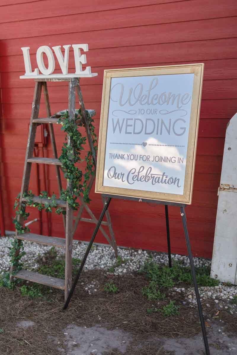 welcome wedding sign on easle