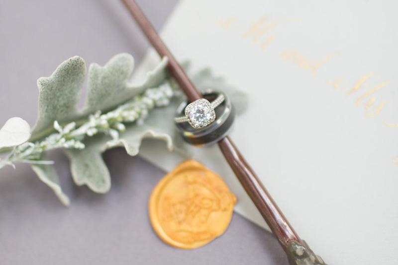 cushion halo engagement ring on wand