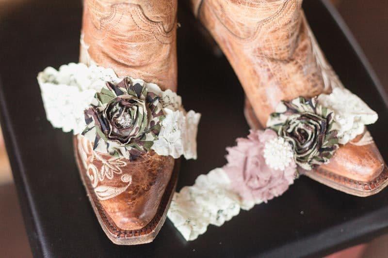 camo wedding garter on cowboy boot