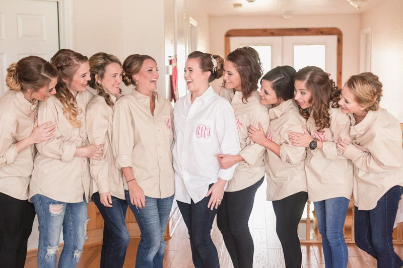 bridesmaids in button up shirts getting ready for an Orlando Barn wedding