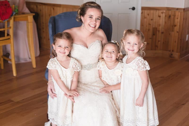 brides with three flower girls in lace dresses