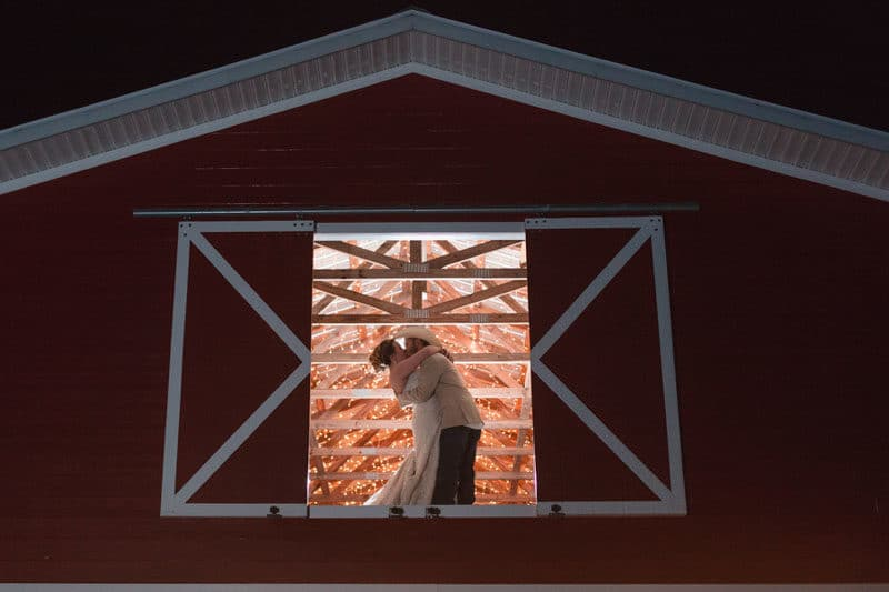 couple kissing in barn for Orlando Barn wedding
