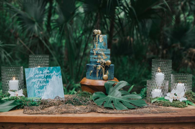 teal and gold tropical dessert table for mermaid inspired wedding shoot