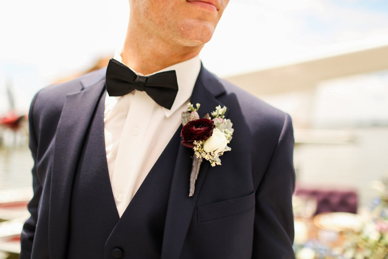 groom's boutonniere with black bow tie