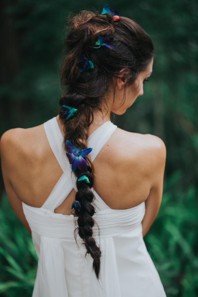 bride with French braid and orchids in hair