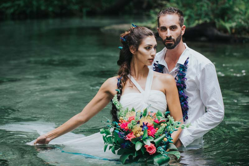 bride and groom in water at Kelly Park