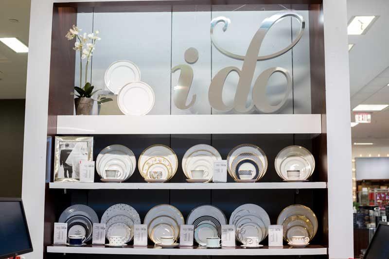 fine china wall display in macys wedding registry department