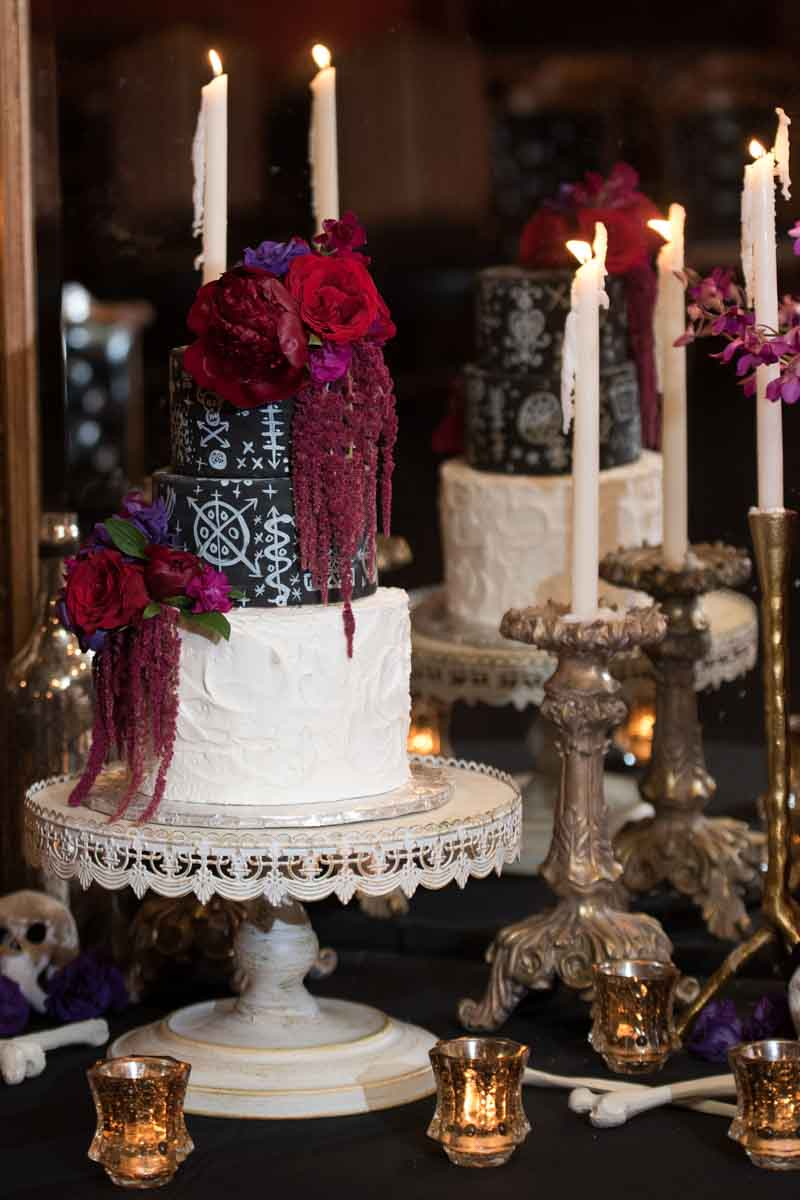 black and white wedding cake with red florals
