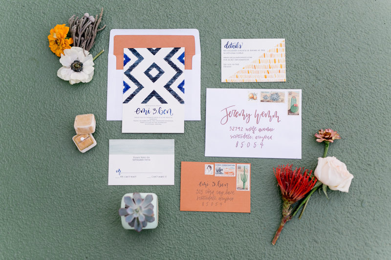 southwestern boho wedding invitations with flowers around it