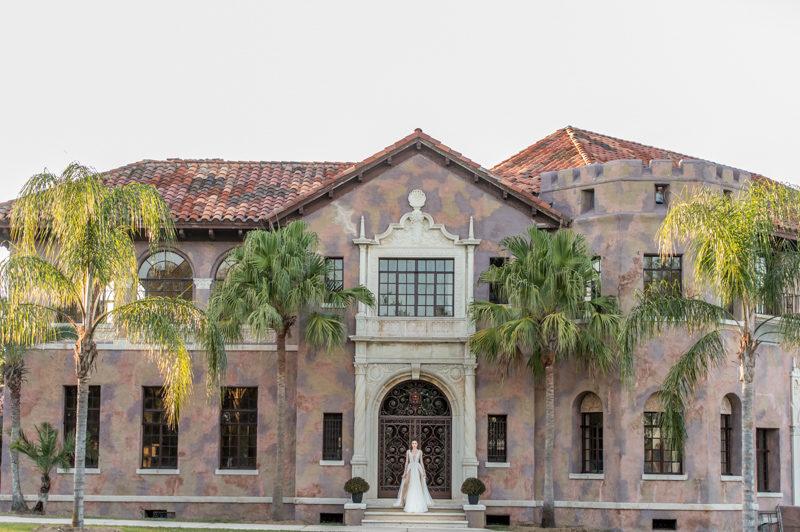 bride standing in front of the Howey Mansion's doors
