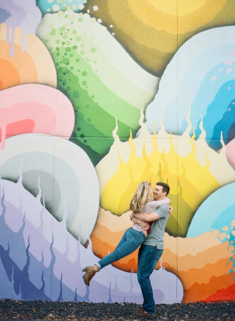 couple twirling in front of St. Pete Wall Mural