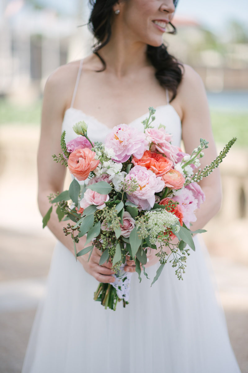 Bride holding colorful bouquet