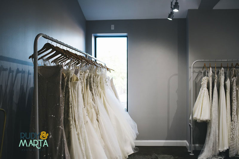 wedding dresses hanging on rack for wedding dress after the wedding article