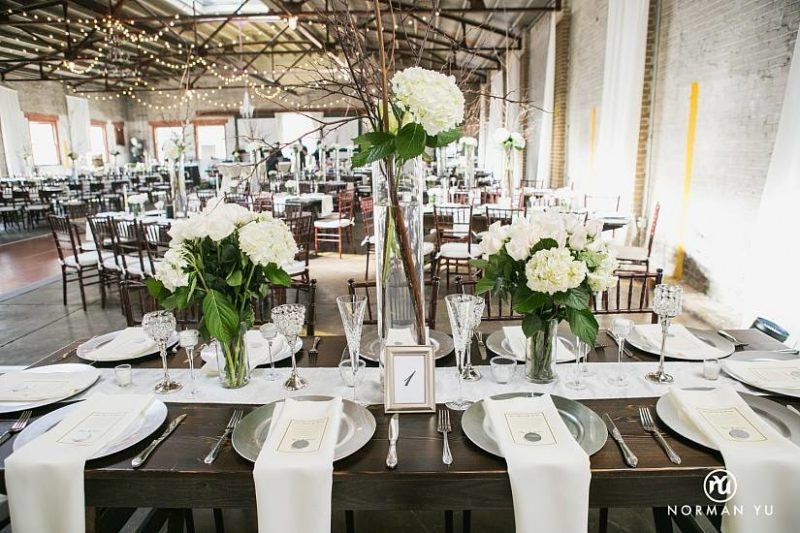 white centerpiece on table for Artisan Alley Garage wedding