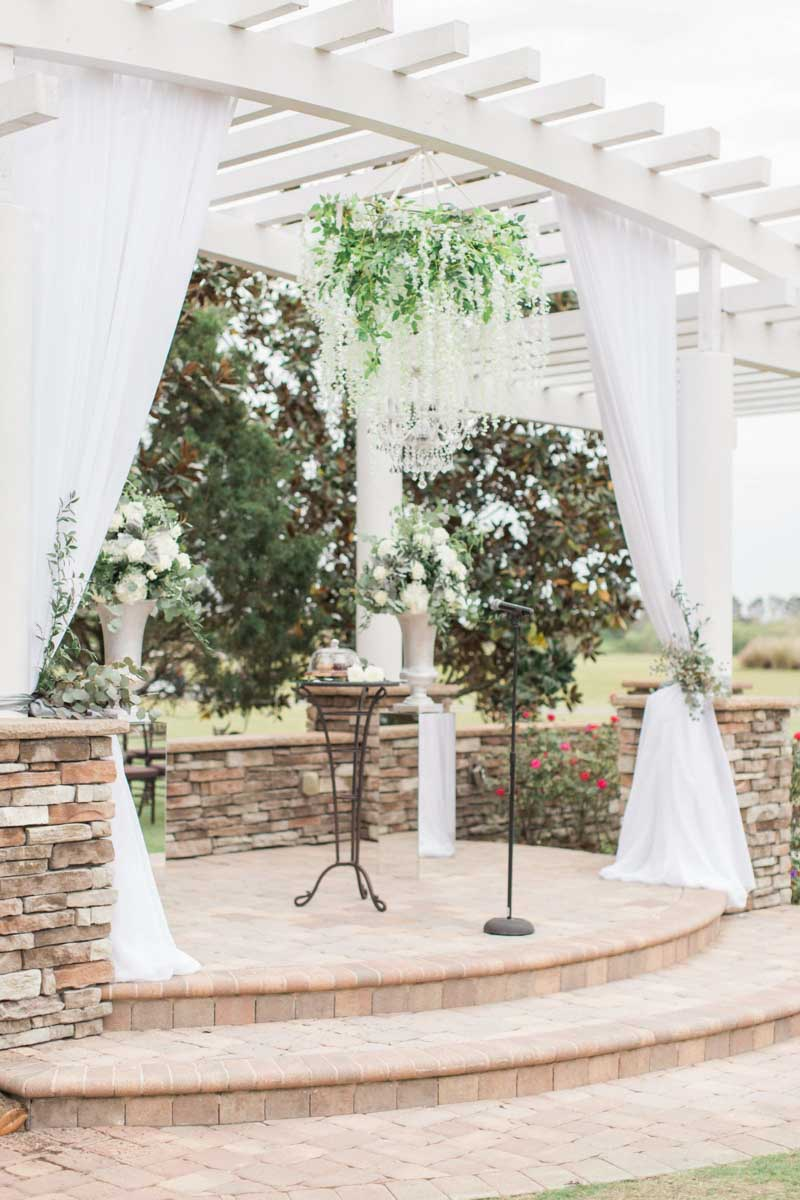 hanging flowers on white pergola at The Royal Crest Room
