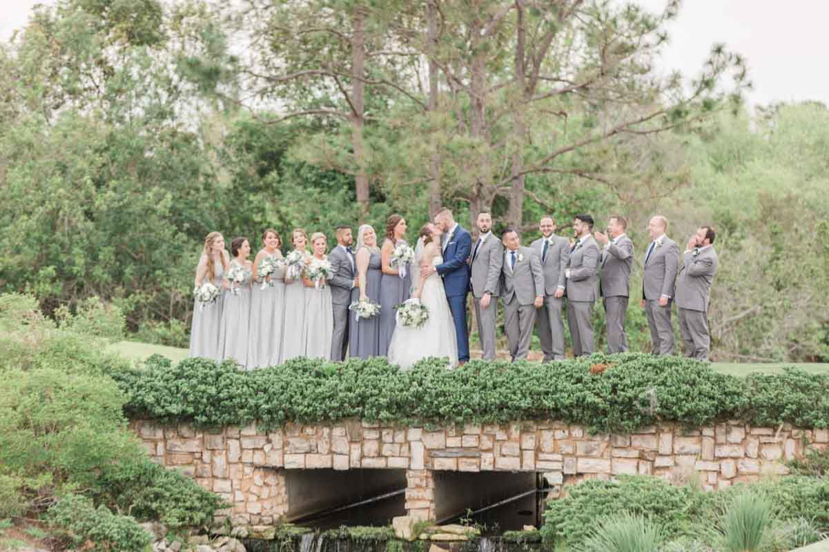 wedding party in grey on bridge at The Royal Crest Room