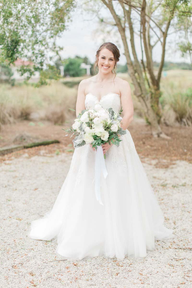 bride in aline wedding dress holding bridal bouquet