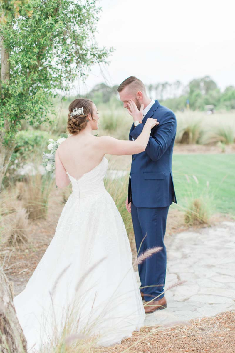 groom crying after seeing bride for the first time during first look