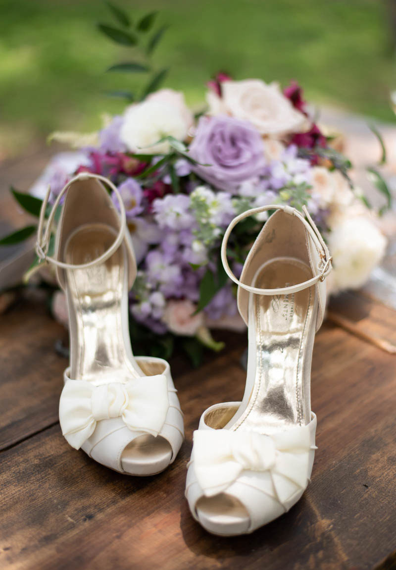 champagne colors bridal shoes in front of lavender bridal bouquet