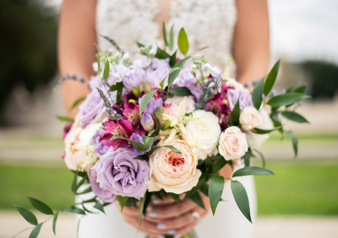 bride holding lavender and blush bridal bouquet