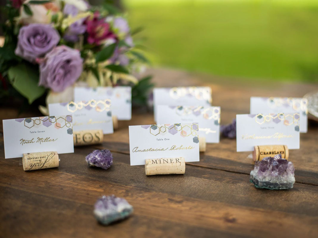geometric escort cards on wine bottle corks
