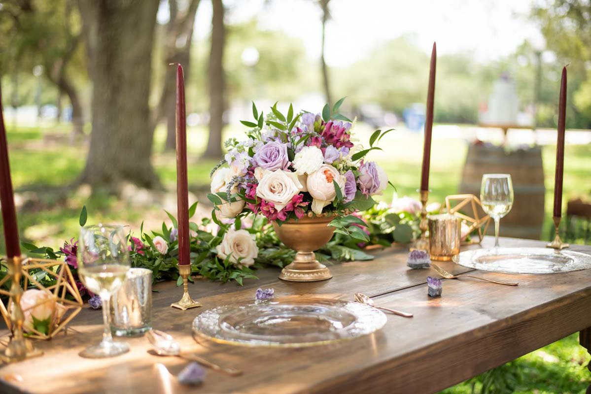 lavender and blush wedding centerpiece in brass container