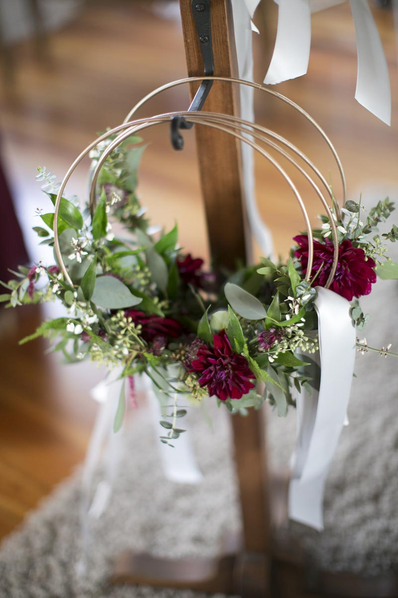 wreath style bridesmaids bouquet hanging on hook