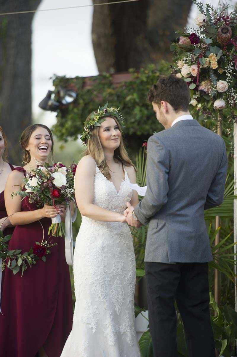 bride smiling at groom as they say their wedding vows