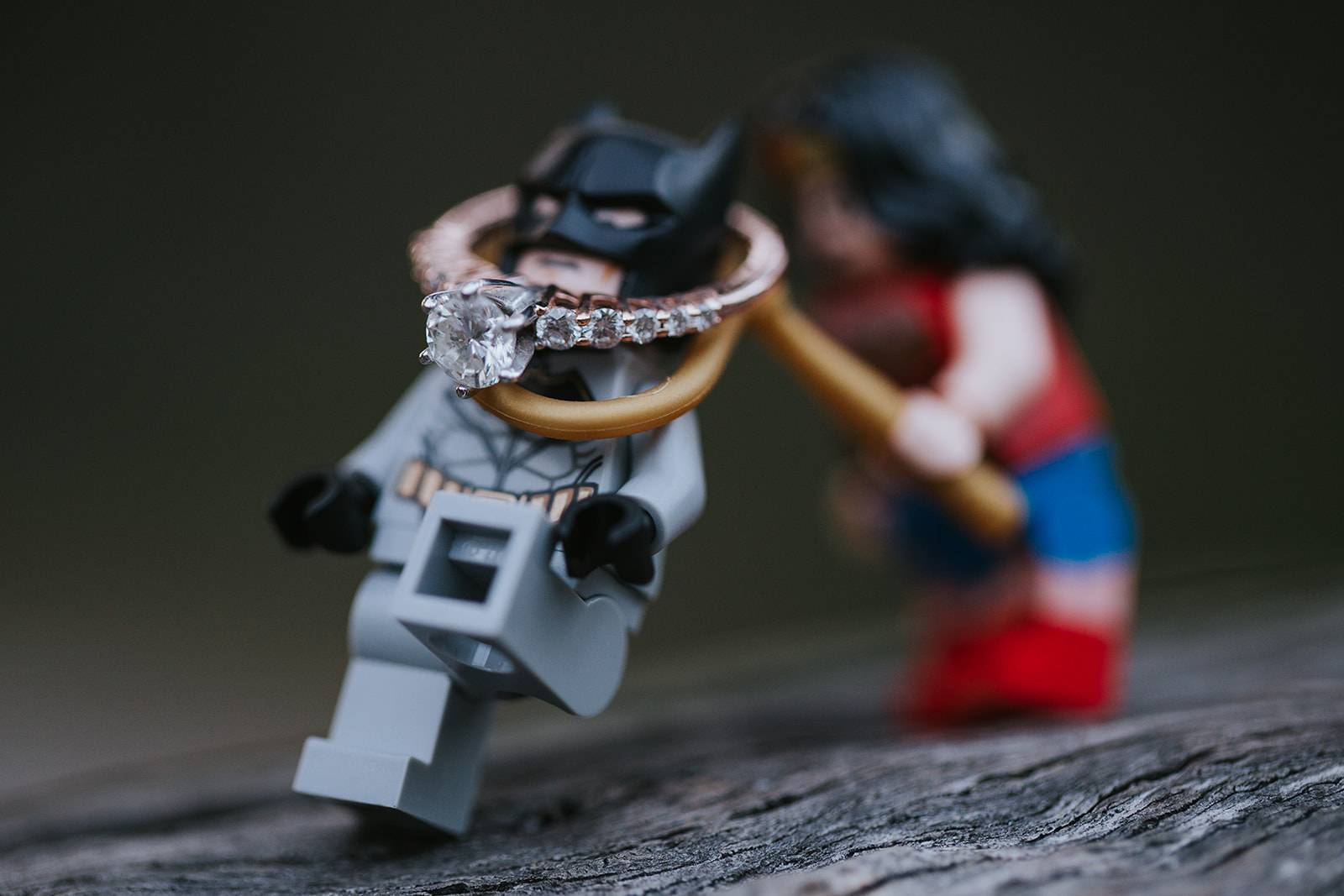 lego wonder woman lassoing batman with engagement ring