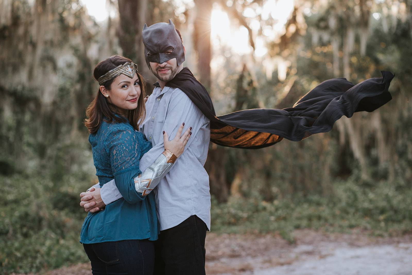 couple dressed like wonder woman and batman for engagement session