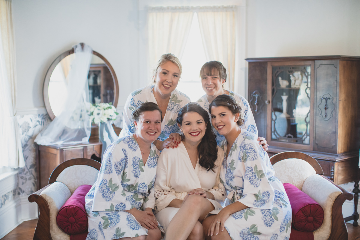 bride and bridesmaids in flower robes getting ready for Highland Manor wedding