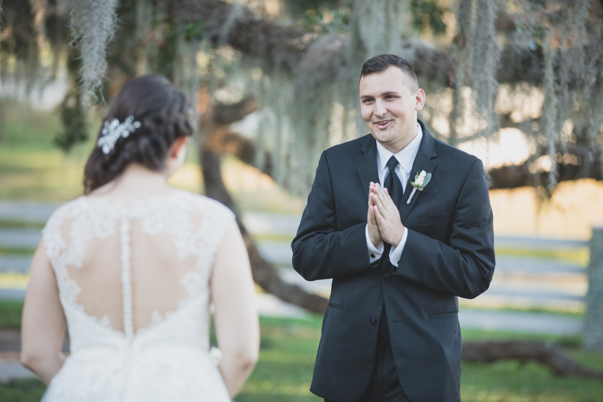 groom smiling when seeing his bride for the first time