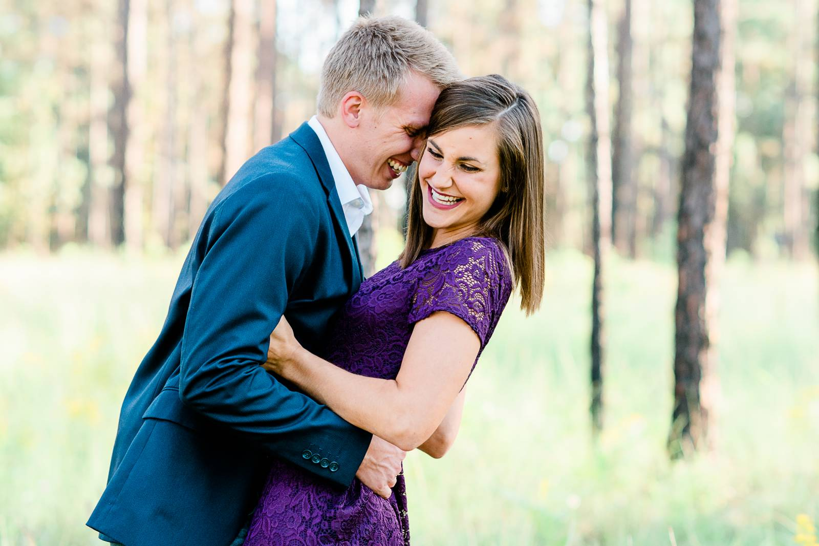 couple laughing and hugging for engagement session