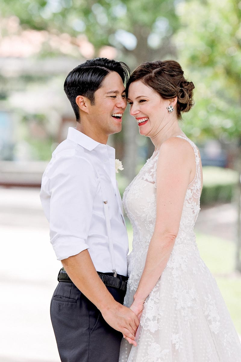 couple laughing in Downtown Winter Garden in wedding attire