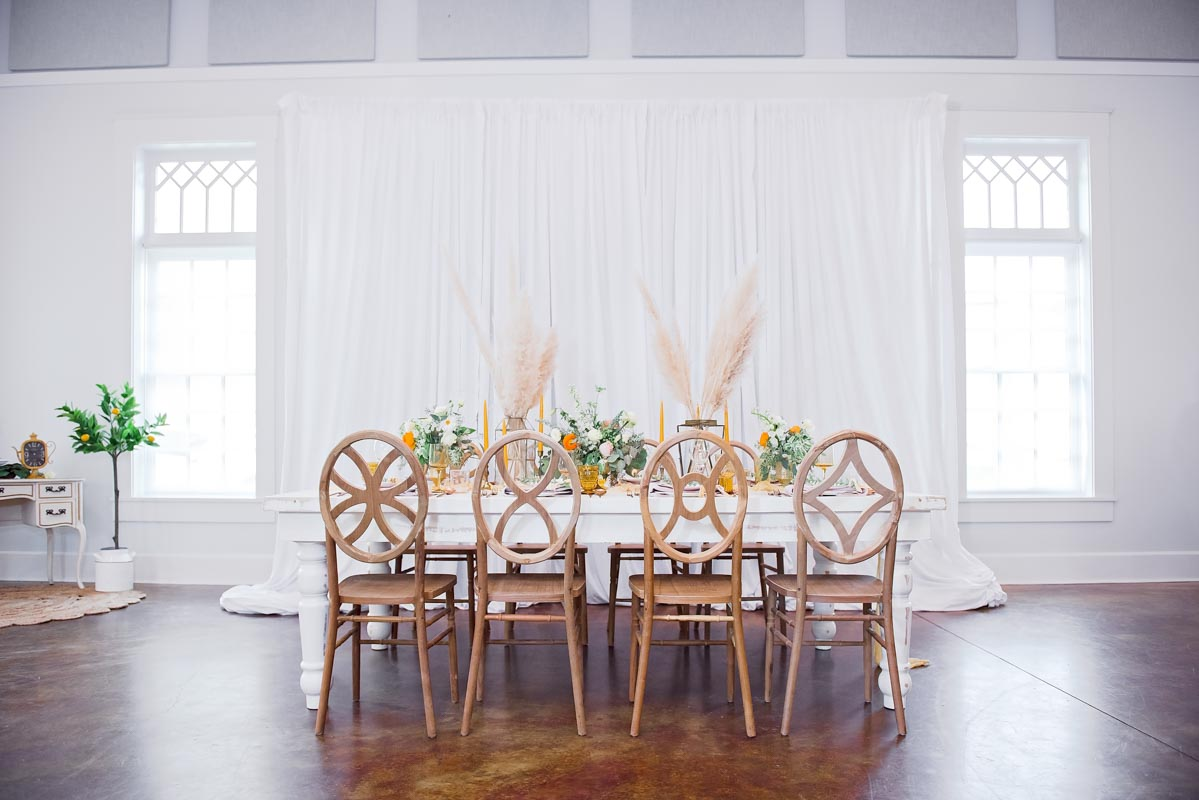 wedding reception set up with pampus grass on the table