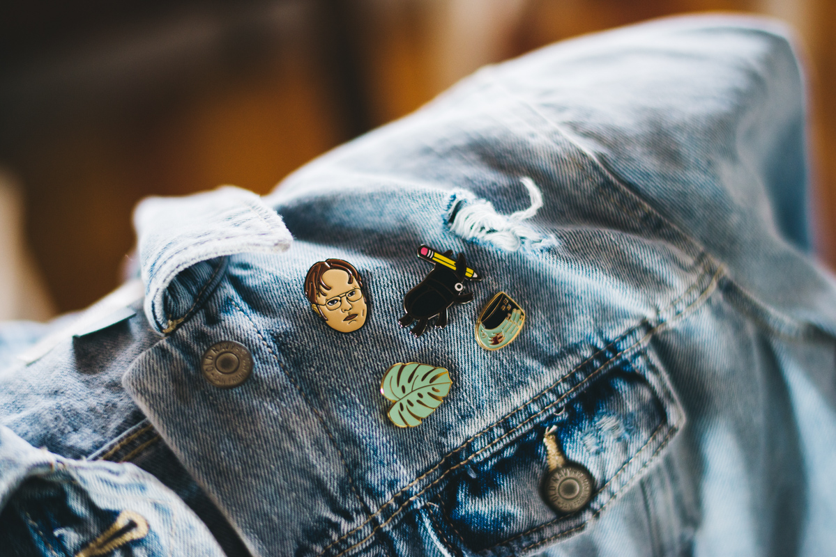 pins on bride's jean jacket for wedding