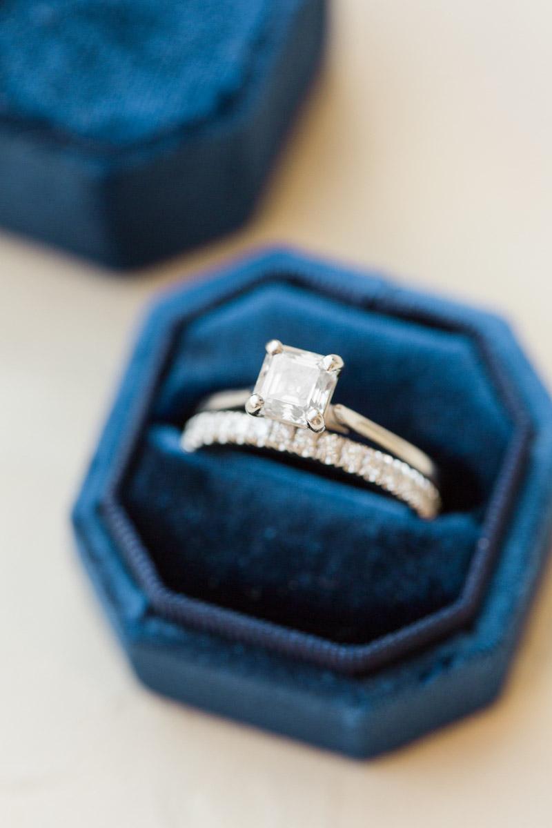 square diamond engagement ring in blue velvet ring box
