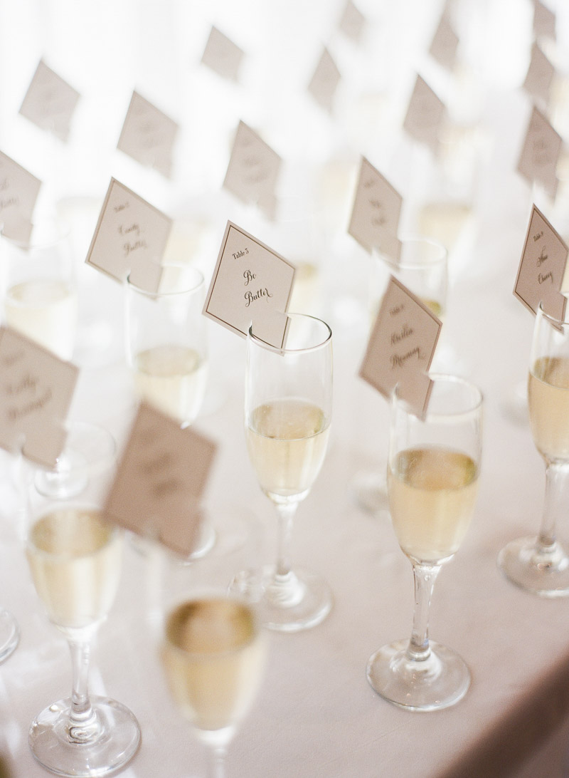escort cards with blue trim on champagne classes
