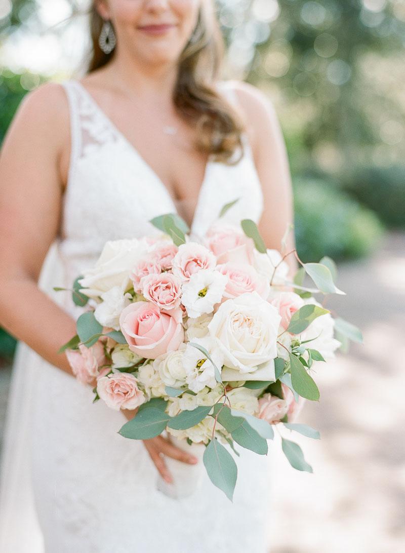 bride holding blush rose and white hydrangea bridal bouquet