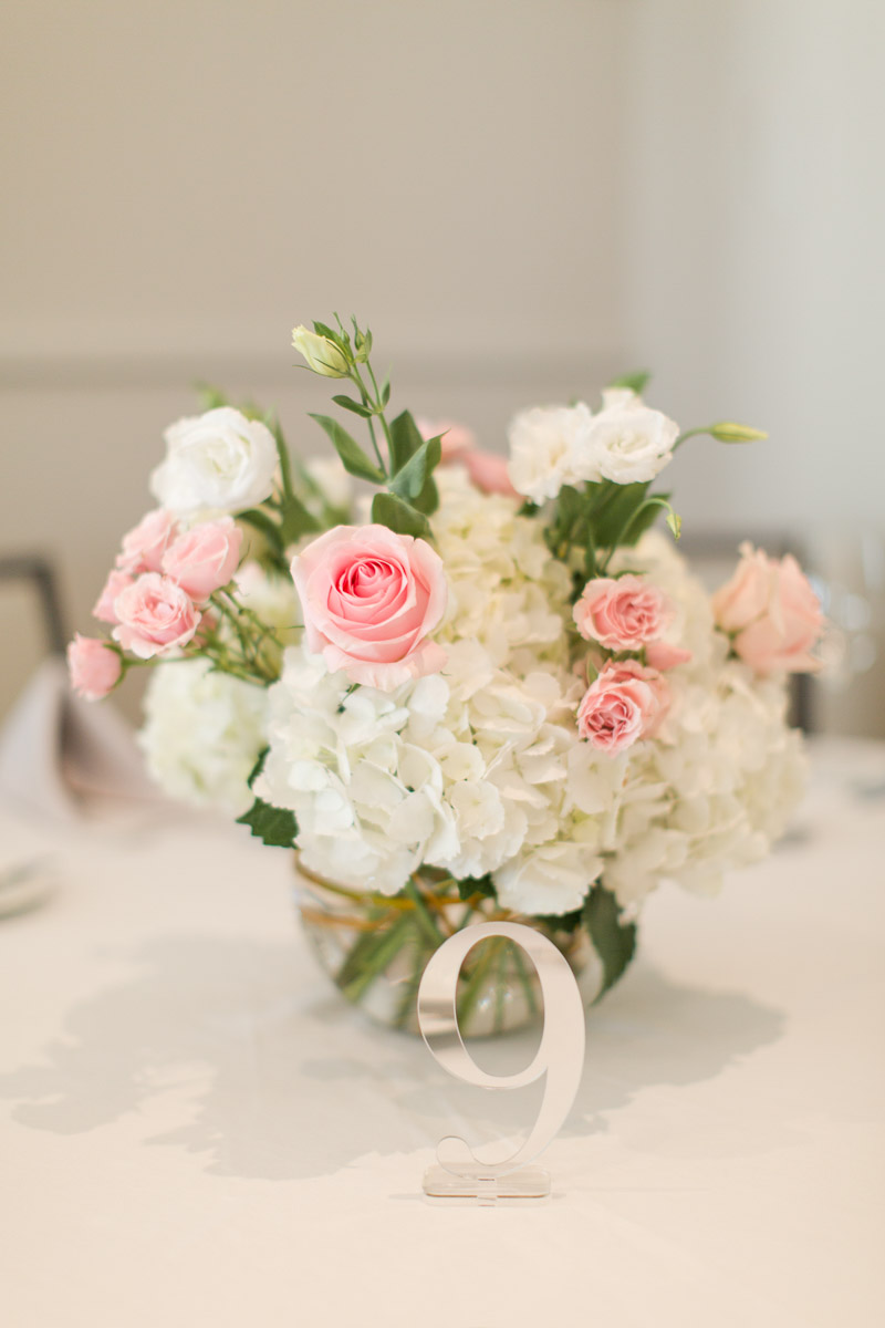 blush rose and white hydrangea wedding centerpiece with gold table number