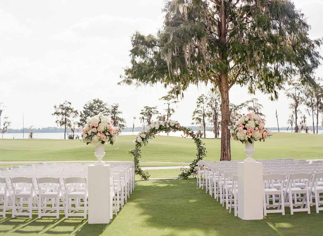 wedding flower arch for wedding ceremony next to lakefront