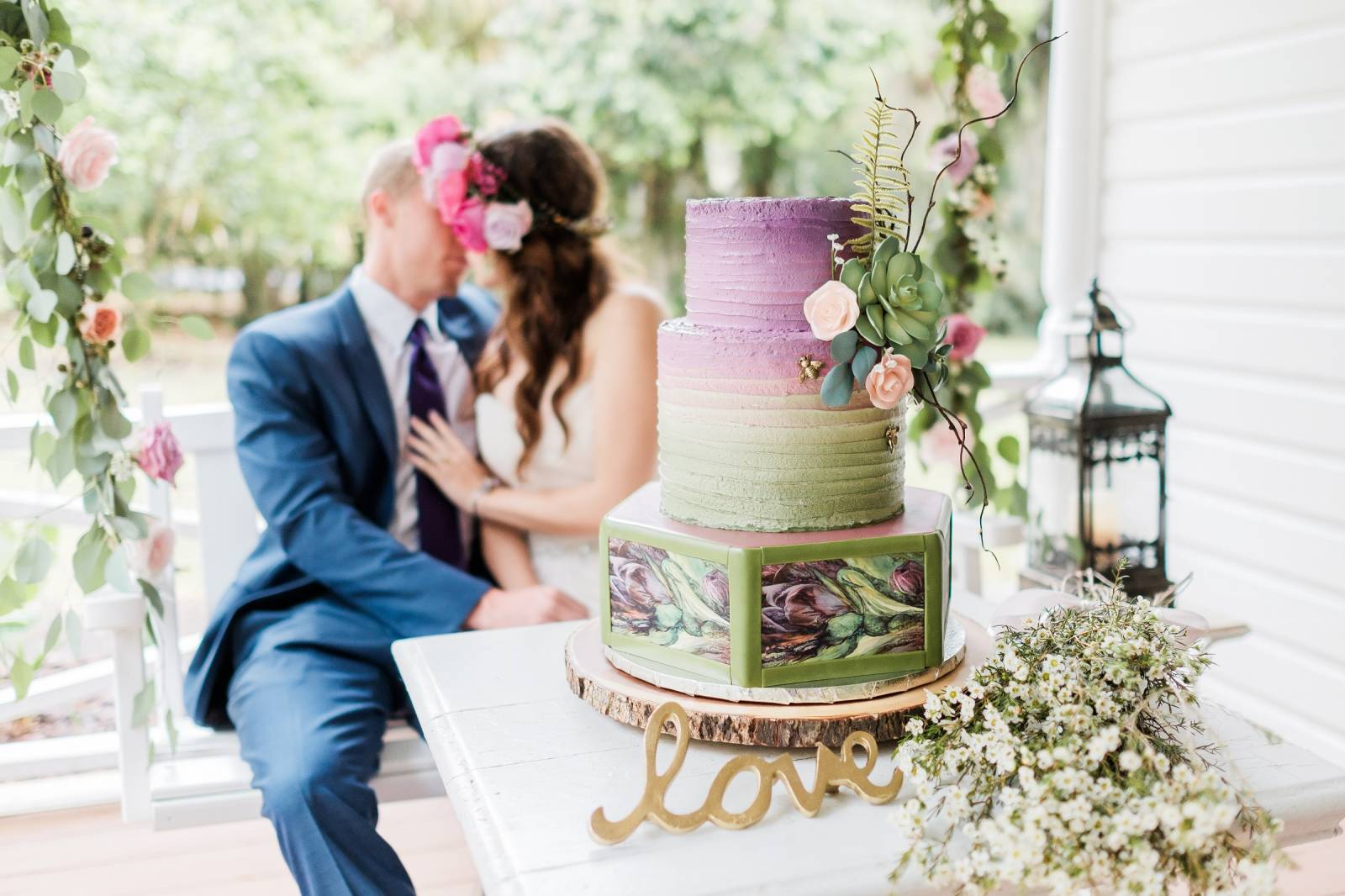 purple and green wedding cake by Couture Cakes