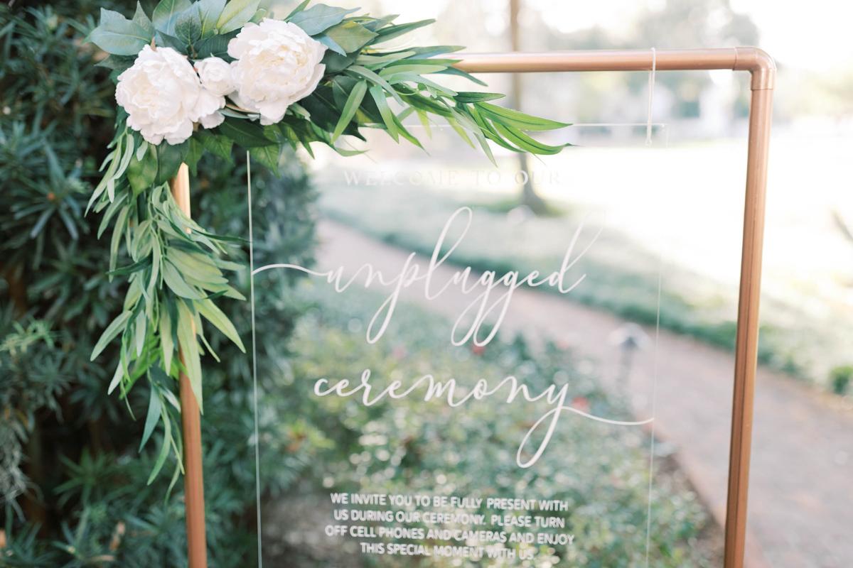 Unplugged wedding ceremony sign.