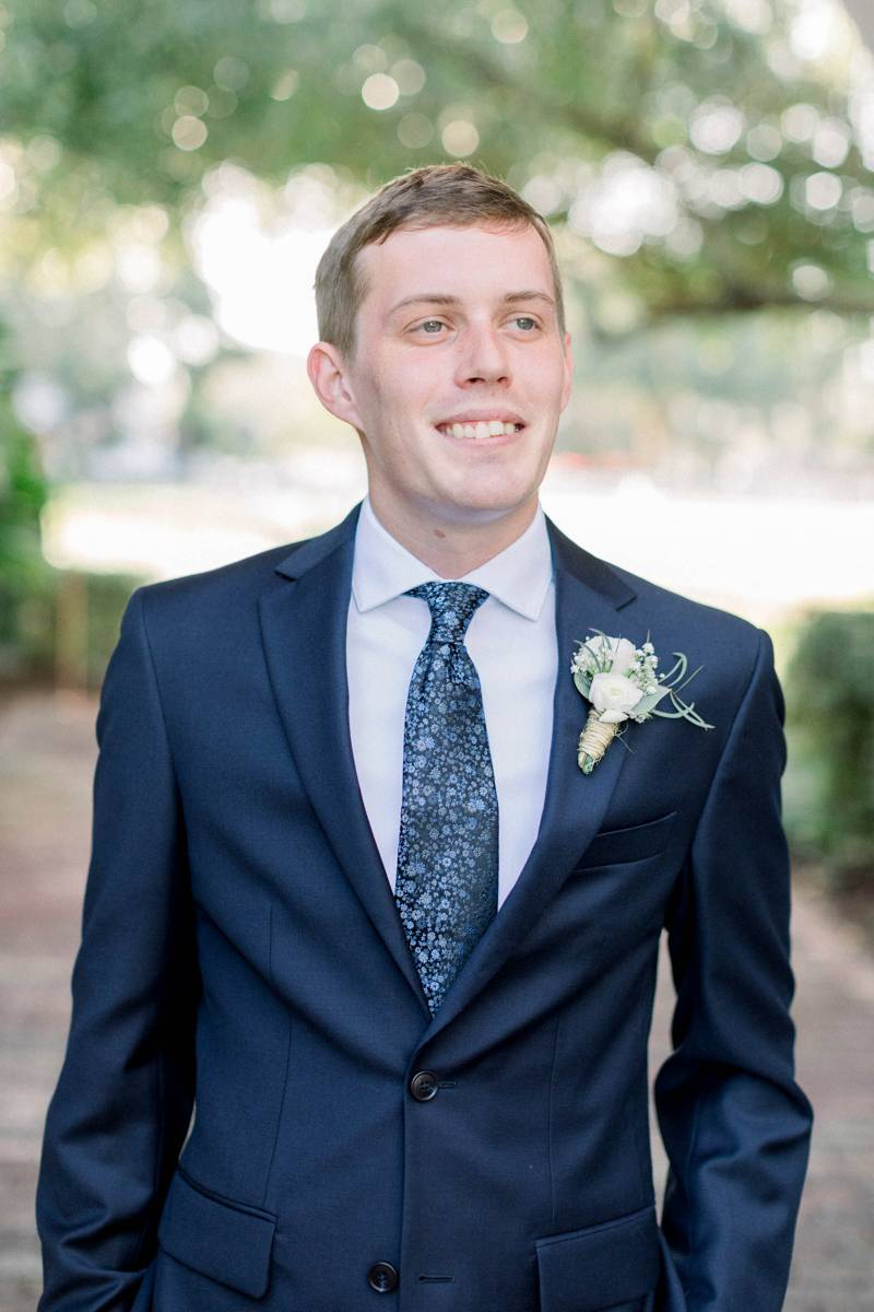 Groom in a blue suit.