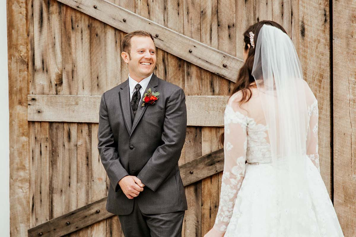 groom smiling when seeing bride for the first time