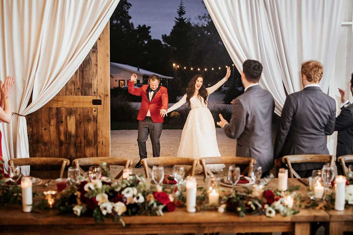 couple's grand reception entrance into barn