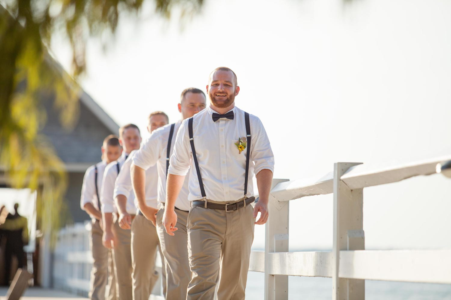 groomsmen walking up dock for Swor Cottage wedding